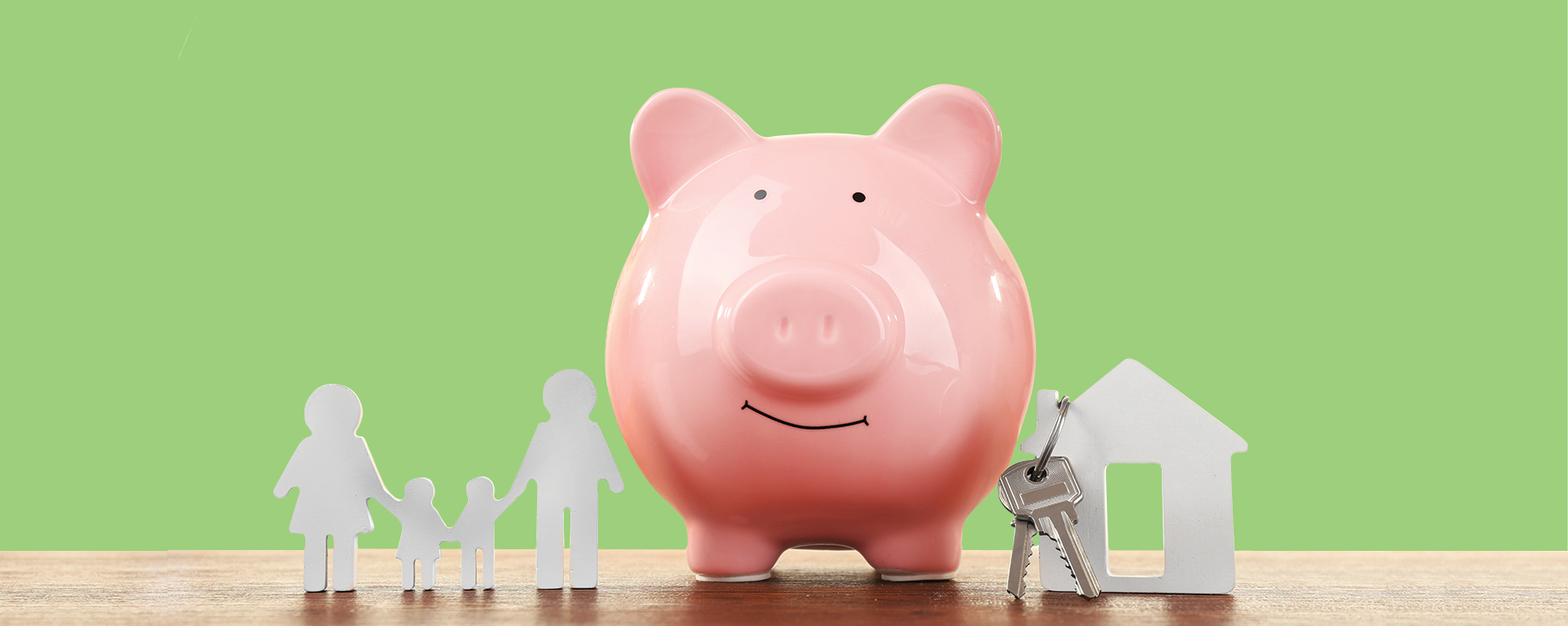 Pink piggy bank on green background - Banner